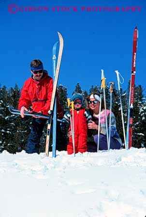 Stock Photo #2583: keywords -  boy child country cross family father fun mother nordic parent play recreation released share ski snow sport together vert winter