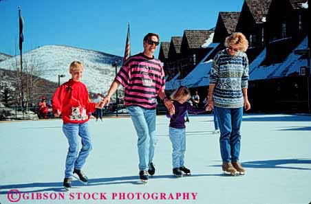 Stock Photo #2589: keywords -  children city family father fun horz ice mother parent park play recreation released share skate skating snow sport team together utah winter