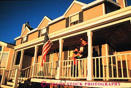 Stock Photo #2595: keywords -  american boy children family father flag home horz house husband mother porch read released son together wife
