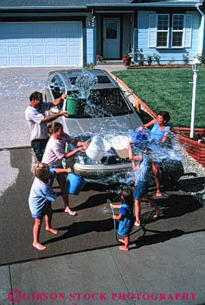 Stock Photo #2596: keywords -  auto bucket car children clean family fight fun home hose house parent play playing plays released residential soak splash splashes splashing summer throw throws together vehicle vert wash water wet