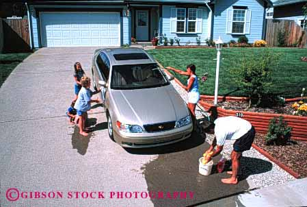 Stock Photo #2599: keywords -  auto bucket car children clean family fun home horz hose house parent play released residential summer together vehicle wash water wet