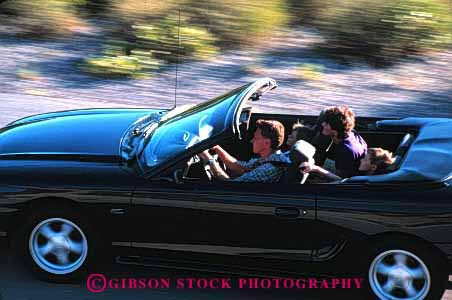 Stock Photo #2601: keywords -  auto blur car children convertible drive family horz husband motion move parent released street summer together travel vehicle