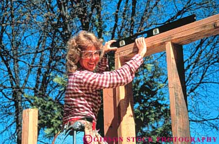 Stock Photo #3490: keywords -  build business busy career carpenter commerce construction craft duty earn educated employ employee employment equipment female frame home horz house job labor level man new occupactions occupation outdoor paid pay paycheck payroll professional released roll task technical tool trade trained vocation wall woman wood work worker