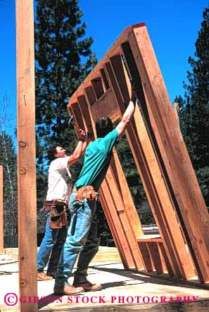 Stock Photo #2665: keywords -  build business career carpenters check construction cooperate employee frame heavy home house income industry job lift lumber men new occupation pay profession push raise released skill square teamwork vert vocation wall wood work