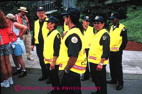 Stock Photo #2672: keywords -  business career check employee ethnic event group horz income job not occupation pay profession skill staff team uniform vest vocation work yellow