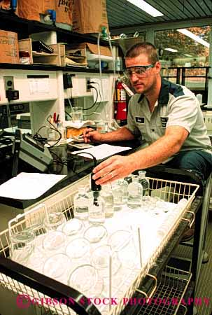 Stock Photo #2698: keywords -  business career check chemistry clean employee income industry job labor laboratory man monitor occupation pay plant profession quality released skill technician test treatment vert vocation water work
