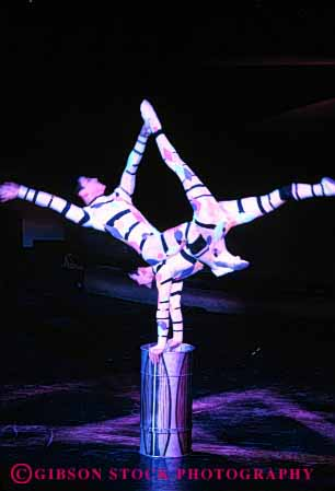 Stock Photo #2738: keywords -  acrobat acrobatic acrobatics acrobats balance balanced balances balancing casino cooperate cooperation coordinate coordinated coordination group las lift luxor men nevada not people perform person practice released skill skilled skills strength teamwork vegas vert
