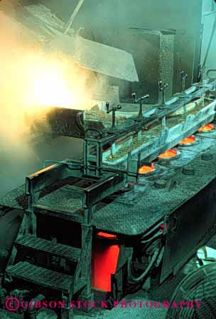 Stock Photo #2767: keywords -  brass burn danger equipment foundry heat hot in industry machine manufacture melt metal molten pour risk safety technology vert