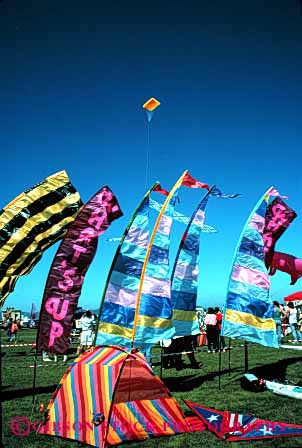 Stock Photo #2795: keywords -  aerodynamic aerodynamics air banners blow color colorful colors design engineer festival flight fly flying geometric geometrical geometry kite lift lifted lifts lightweight material row rows sky soar string style synthetic vert wind