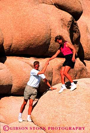 Stock Photo #2803: keywords -  affection assist california careful caution couple desert fun hand help hike hold husband intimate joshua national outdoor park play recreation released rock share summer together tree vert wife