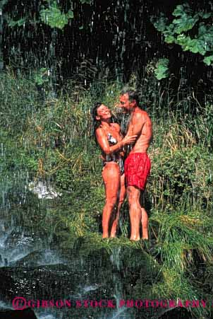 Stock Photo #2807: keywords -  affection couple embrace fun hug husband intimate landscape lush outdoor play recreation released scenic share summer together vert water waterfall wet wife wilderness