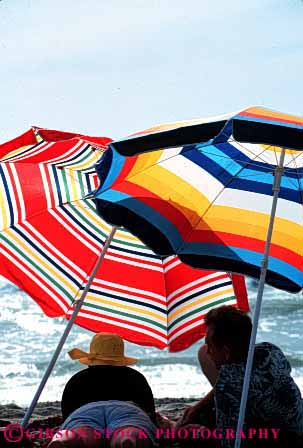 Stock Photo #2813: keywords -  affection beach coast couple fun husband intimate not ocean outdoor play recreation released shade share summer sun sunshine together umbrella under vert wife