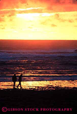 Stock Photo #2817: keywords -  alone beach calm couple dusk intimate love ocean orange peaceful quiet romantic share silhouette solitude summer sunset together vacation vert warm washington water yellow