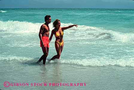 Stock Photo #2820: keywords -  affection beach calm couple florida fun hand hold honeymoon horz husband intimate love ocean play private released share solitude stroll summer sun sunshine surf swim tan together travel vacation wade walk water wife