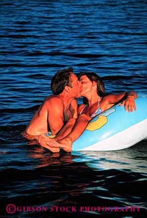Stock Photo #2823: keywords -  affection beach calm couple fun honeymoon husband intimate kiss love ocean play private released share solitude summer sun sunshine swim tan together travel tube vacation vert water wife