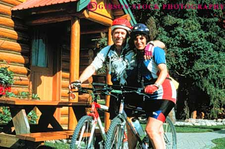 Stock Photo #3451: keywords -  adventure affection banff bicycle bike cabin canada close cooperate couple couples equipment exercise horz love mountain outdoor partner released ride share sport summer together vacation
