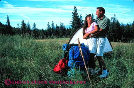 Stock Photo #2842: keywords -  affection alone backpack camp camping couple fun hike horz hug husband intimate play private released share snuggle solitude summer sun sunshine tent together travel wife