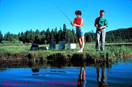 Stock Photo #2844: keywords -  affection alone couple fish fishing fun horz husband intimate lake play private released share solitude sport summer sun sunshine together travel wife