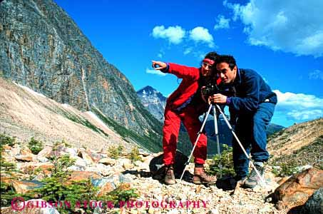 Stock Photo #2846: keywords -  adventure affection alone camera couple ethnic fun horz husband intimate landscape photo photography play private released share solitude summer sun sunshine team together travel wife wilderness