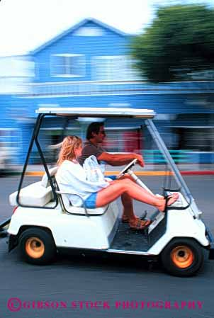 Stock Photo #2860: keywords -  affection blur cart couple drive fun golf husband intimate love motion movement relax released share summer together travel vacation vehicle vert wife