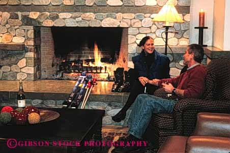 Stock Photo #2863: keywords -  affection apre couple cozy fireplace horz husband intimate love refresh relax released resort share ski skiing snow together warm wife winter