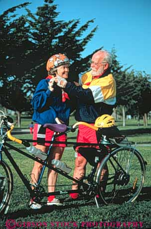 Stock Photo #3459: keywords -  assist bicycle bike cooperate couple couples equipment exercise helmet outdoor released ride senior share summer tandem team vert