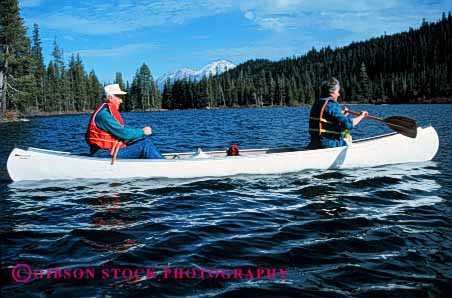Stock Photo #2884: keywords -  active boat canoe canoeing couple elderly exercise fitness float grandparent health horz husband lake mature paddle recreation released senior share sport team together water wife workout