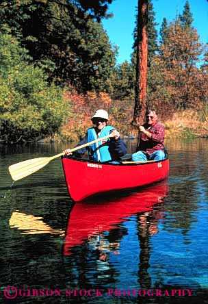 Stock Photo #2885: keywords -  active boat canoe canoeing couple elderly exercise fitness float grandparent health husband lake mature paddle recreation released senior share sport team together vert water wife workout