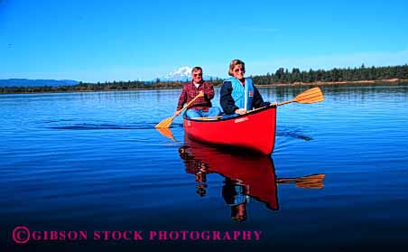 Stock Photo #2887: keywords -  active boat canoe canoeing couple elderly exercise fitness float grandparent health horz husband lake mature paddle recreation released senior share sport team together water wife workout