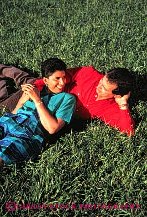Stock Photo #2893: keywords -  affection chicano colorful couple grass hispanic husband intimate lawn love mexican minority relax released share smile together vert wife
