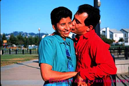 Stock Photo #2896: keywords -  affection chicano colorful couple hispanic horz hug husband intimate kiss love mexican minority released share smile together wife