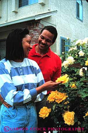 Stock Photo #2901: keywords -  african american black couple flowers home husband intimate minority released residential share smell summer together vert wife