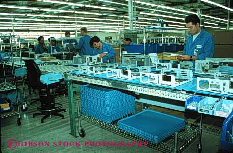 Stock Photo #2935: keywords -  assemble assembly computer control employee factory horz job laboratory line machine manufacturer quality technology work