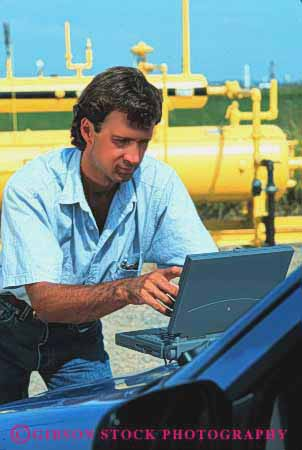 Stock Photo #2940: keywords -  battery business casual compute computer computers data equipment field industrial laptop man outdoor outdoors outside portable powered process released remote site technician technology using vert