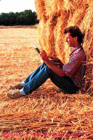 Stock Photo #2942: keywords -  agriculture alone bale battery business casual compute computer computers concentrate data equipment farm farmer field in laptop man outdoor outside peaceful people person portable powered process quiet relax released remote solitude straw technology using vert