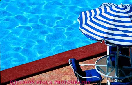 Stock Photo #2963: keywords -  chair destination horz pool relax shade swim swimming travel umbrella water wet
