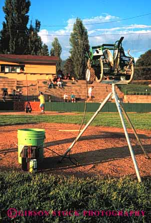 Stock Photo #2970: keywords -  accurate baseball dependable equipment industry machine mechanical moving parts pitching predict repeat technology throw tripod vert