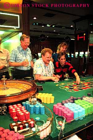 Stock Photo #2977: keywords -  bet casino chance gamble gambling game loose odds released risk roulette vert win