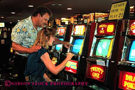Stock Photo #2979: keywords -  bet casino chance couple gamble gambling game horz loose machine odds released risk share slot together vacation win