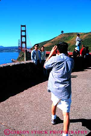 Stock Photo #6163: keywords -  asian bridge ethnic explore foreign gate golden group minority photo photograph pose race travel travelers traveling vacation vert visit visitor
