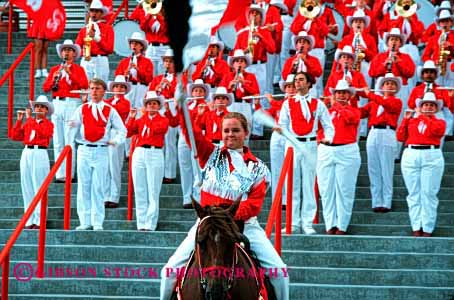 Stock Photo #3078: keywords -  band celebrate colorful coordinate horz marching move music musician noise not parade performance practice red released row show sound team together uniform walk