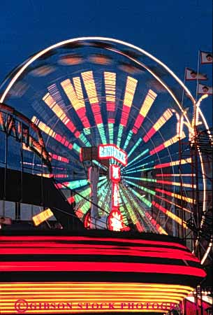Stock Photo #3433: keywords -  abstract amusement exposure lighting motion neon night ride rotation time vert
