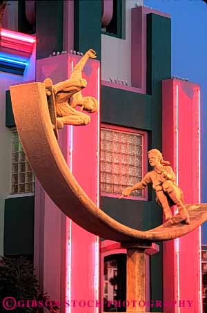 Stock Photo #6157: keywords -  advertise advertisement art beach bright cocoa color colorful dusk front jon light lighting neon pink ron sculpture sign skateboard store surfshop vert
