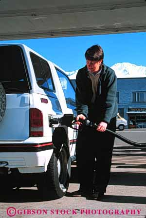 Stock Photo #3145: keywords -  auto car fuel gas gasoline handle hose industry machine nozzle people person petroleum pump pumping pumps recovery released service station transportation valve vapor vehicle vert woman