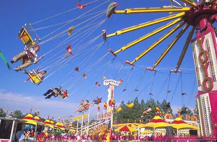 ethnic children on thrill ride California State Fair in