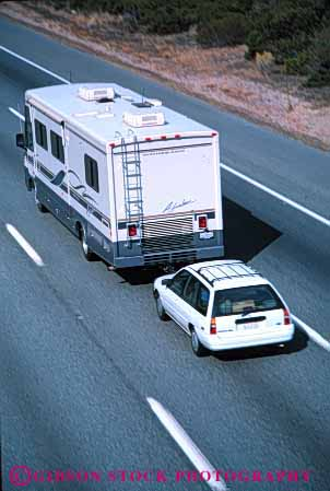 Stock Photo #3207: keywords -  car caution convenient drive highway home large motor motorhome pull recreational risk rv safety second tow travel vacation vehicle vert