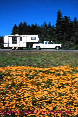 Stock Photo #3211: keywords -  blur camp camper convenient dynamic highway motion movement pick pull recreational rv tow trailer travel truck up vacation vehicle vert