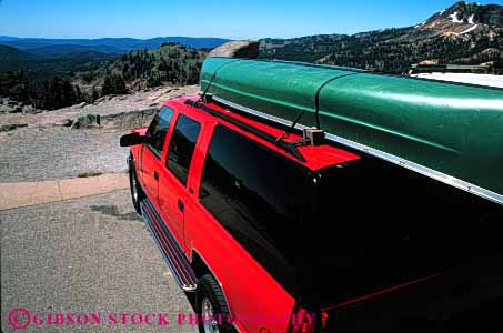Stock Photo #3230: keywords -  camp camper canoe convenient highway horz recreational red rv sport travel utility vacation vehicle