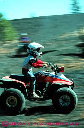 Stock Photo #3241: keywords -  all atv auto blur car child drive engine frame helmet machine motion movement off orv recreational road terrain vehicle vert