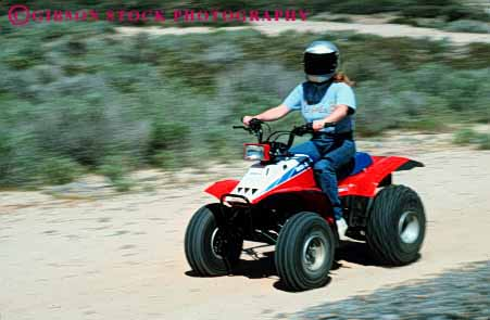 Stock Photo #3242: keywords -  all atv auto blur car drive engine frame helmet horz machine motion movement off orv recreational road terrain vehicle woman